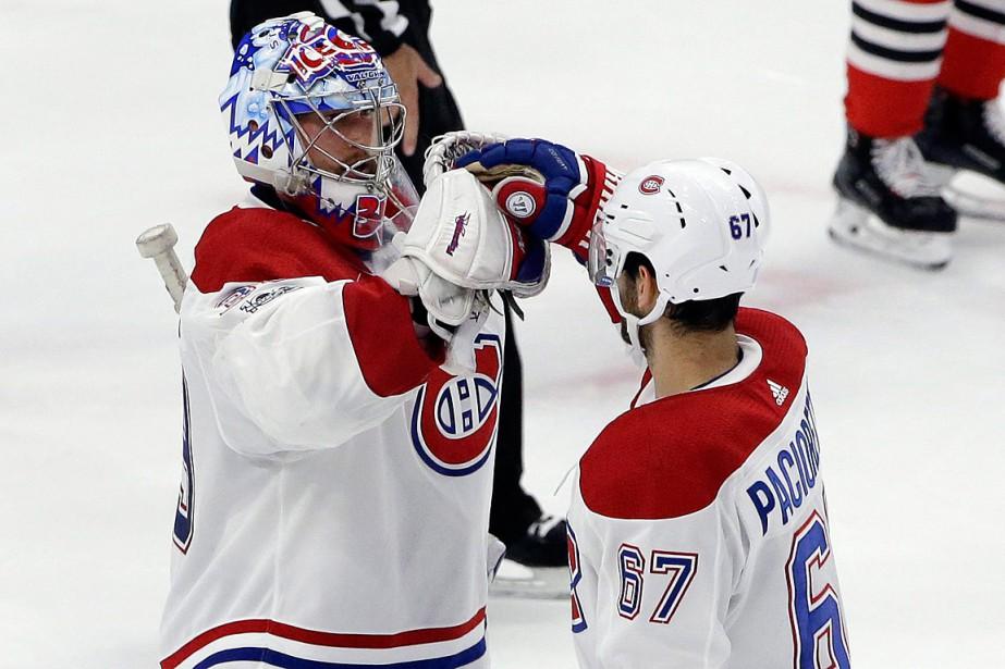 Montreal Canadiens goalie Charlie Lindgren, top, celebrates with...