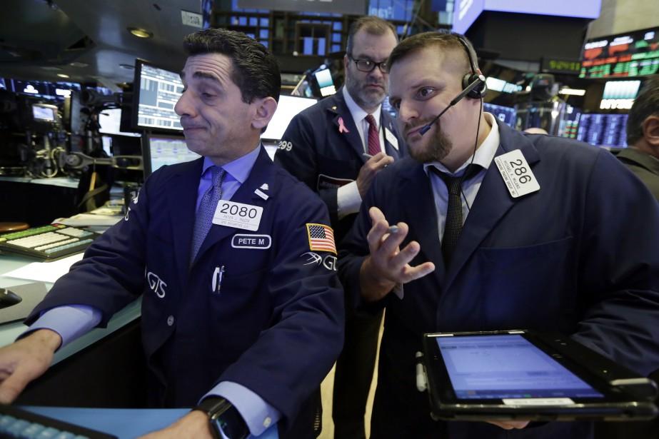 «Les marchés continuent de s'accrocher à un contexte... (AP)