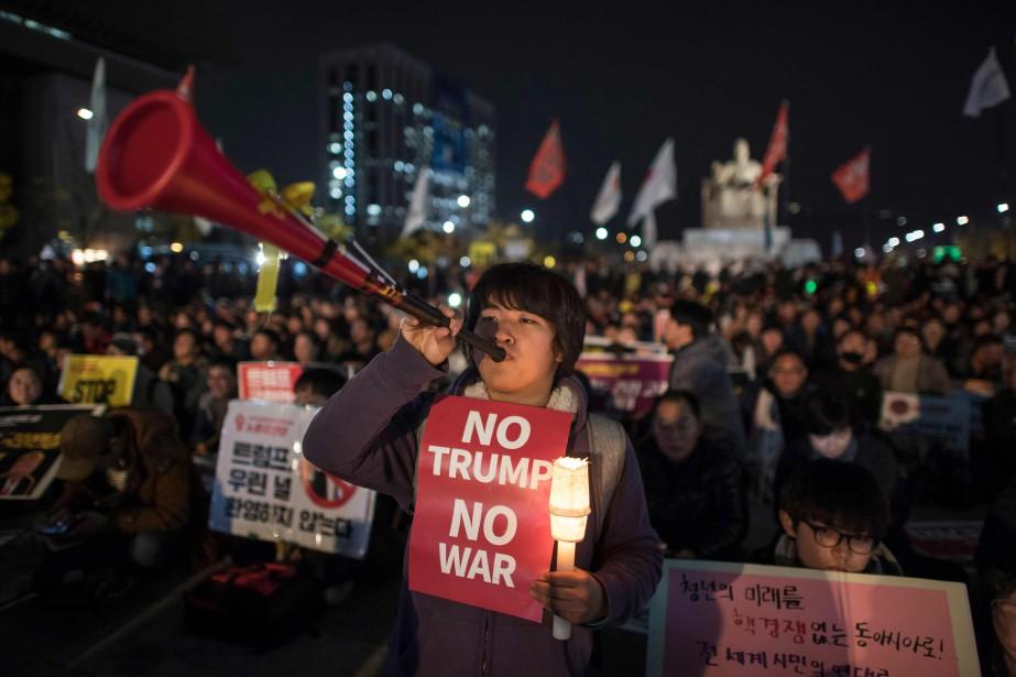 Des manifestants ont notamment protesté contre Donald Trump... (PHOTO Ed JONES, AFP)