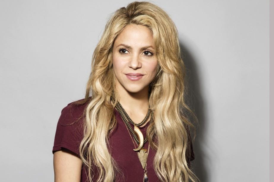 La chanteuse colombienne Shakira a reporté ses premiers... (Photo archives AP)