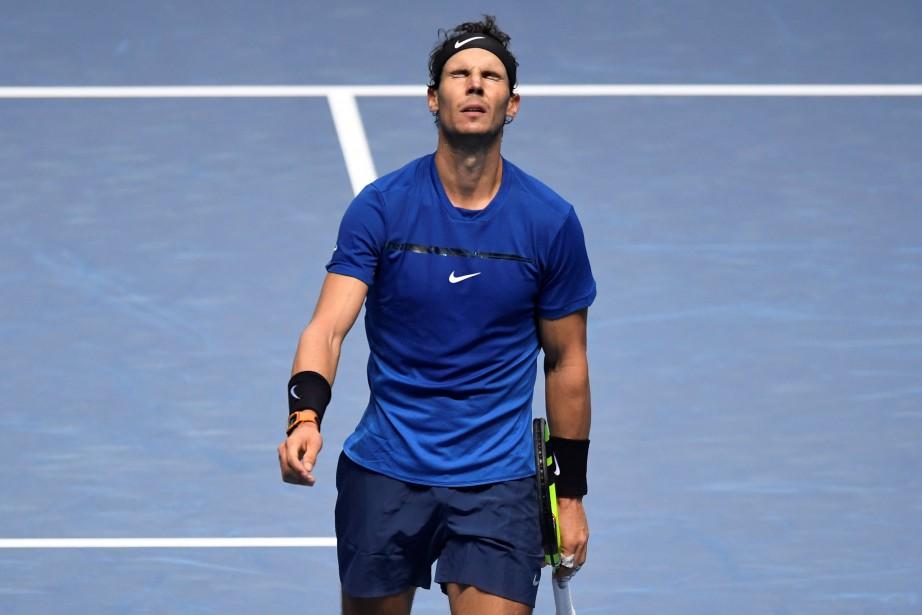 Rafael Nadal était déjà blessé au genou droit... (photo Tony O'Brien, REUTERS)