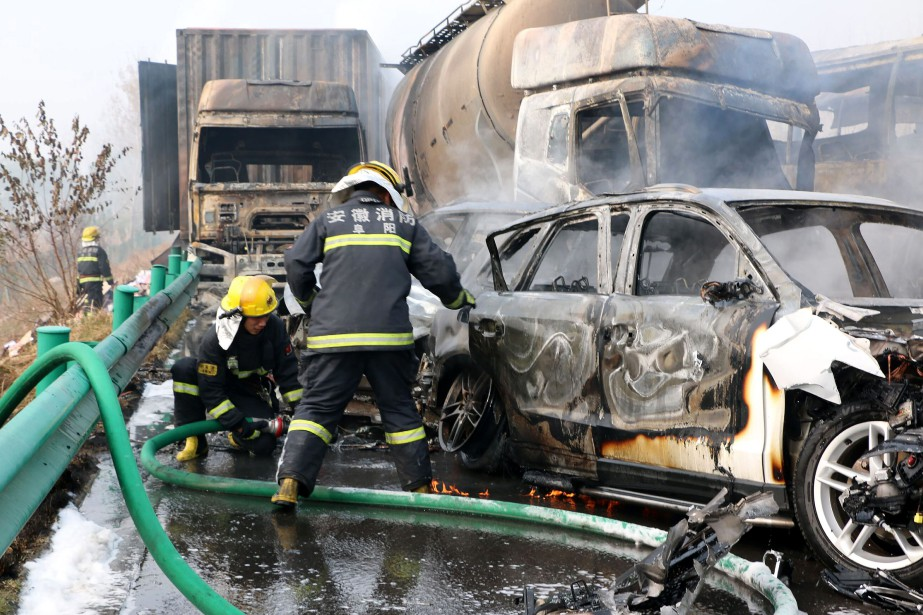Firefighters work to put out fires in vehicles... (AP)