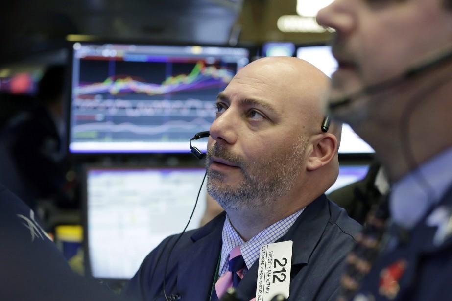 «Les principaux indices se sont affichés en baisse... (AP)