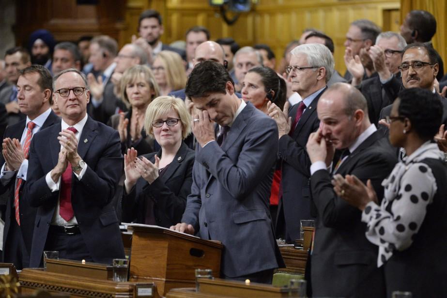 «C'est avec honte, tristesse et un profond regret... (Photo Adrian Wyld, La Presse Canadienne)