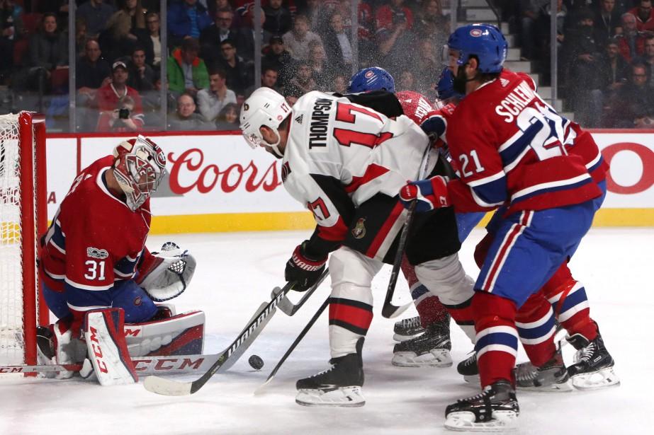 Carey Price bloque un tir de Nate Thompson... (Photo Jean-Yves Ahern, USA TODAY Sports)