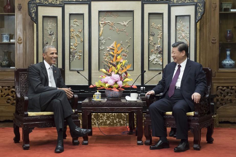 Barack Obama et Xi Jinping.... (Photo Li Xueren, Xinhua via AP)