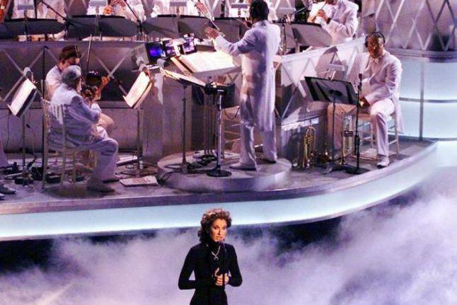 Céline Dion chantant My Heart Will Go On... (PHOTO TIMOTHY A. CLARY, FOURNIE PAR LES PRODUCTIONS FEELINGS)