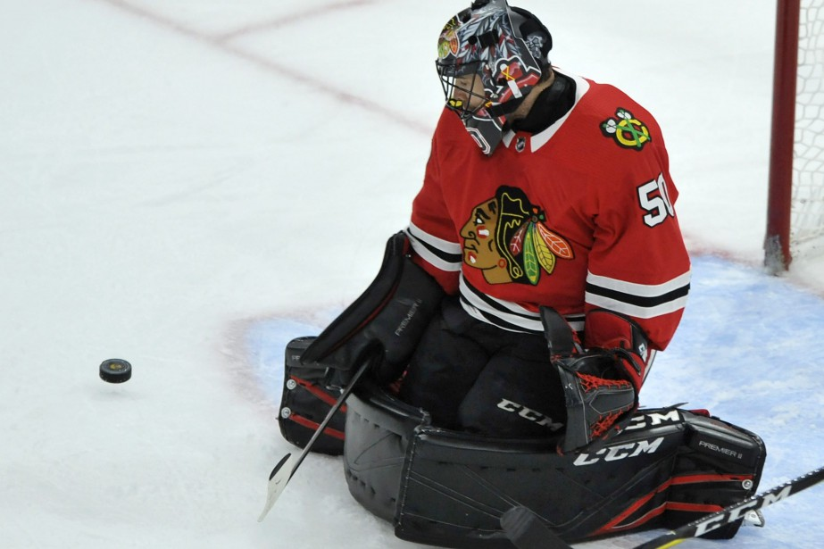 Le gardien Corey Crawford se serait blessé contre... (Photo Paul Beaty, AP)