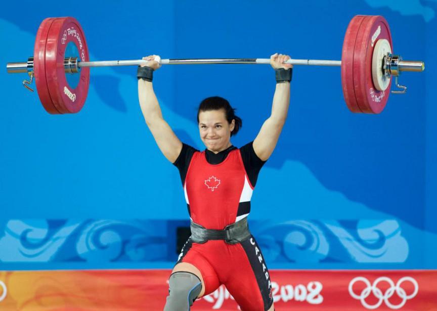 En 2008, aux Jeux de Pékin, l'haltérophile Christine... (Photo Adrian Wyld, Archives La Presse canadienne)