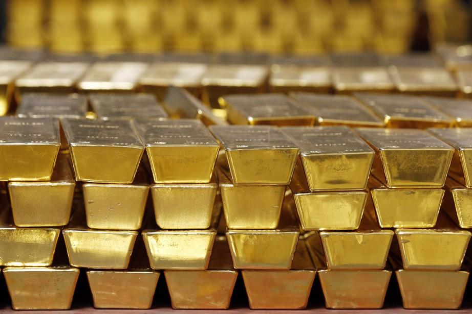 L'once d'or a touché vendredi 1243,43 dollars américain,... (Photo AP)