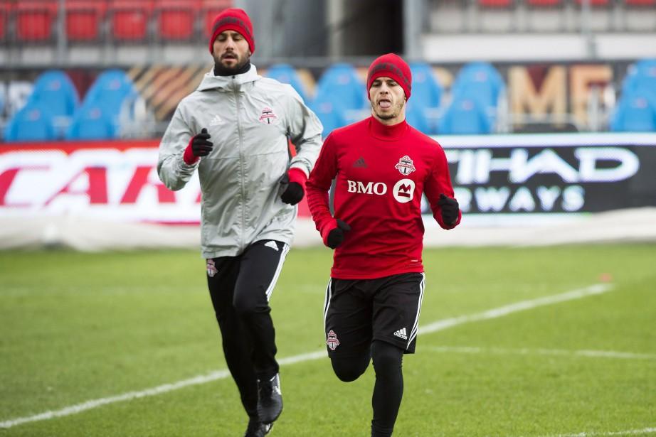 Victor Vazquez etSebastian Giovinco, du Toronto FC, à... (Photo Nathan Denette, PC)