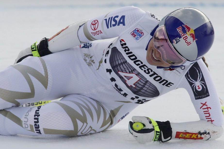 Lindsey Vonn grimace après avoir terminé sa descente.... (Photo Giovanni Auletta, AP)
