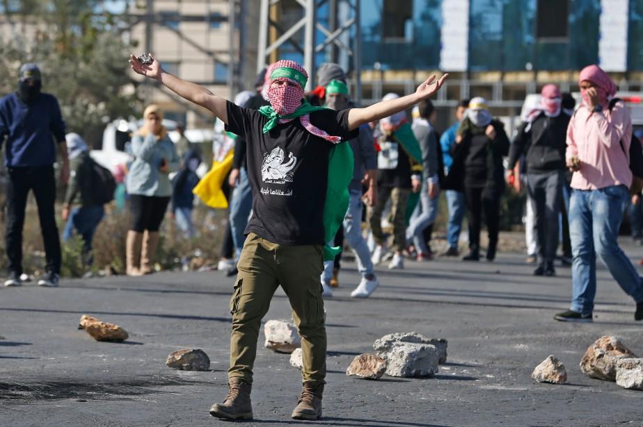 Dans les Territoires palestiniens, des dizaines de jeunes,... (Photo AFP)