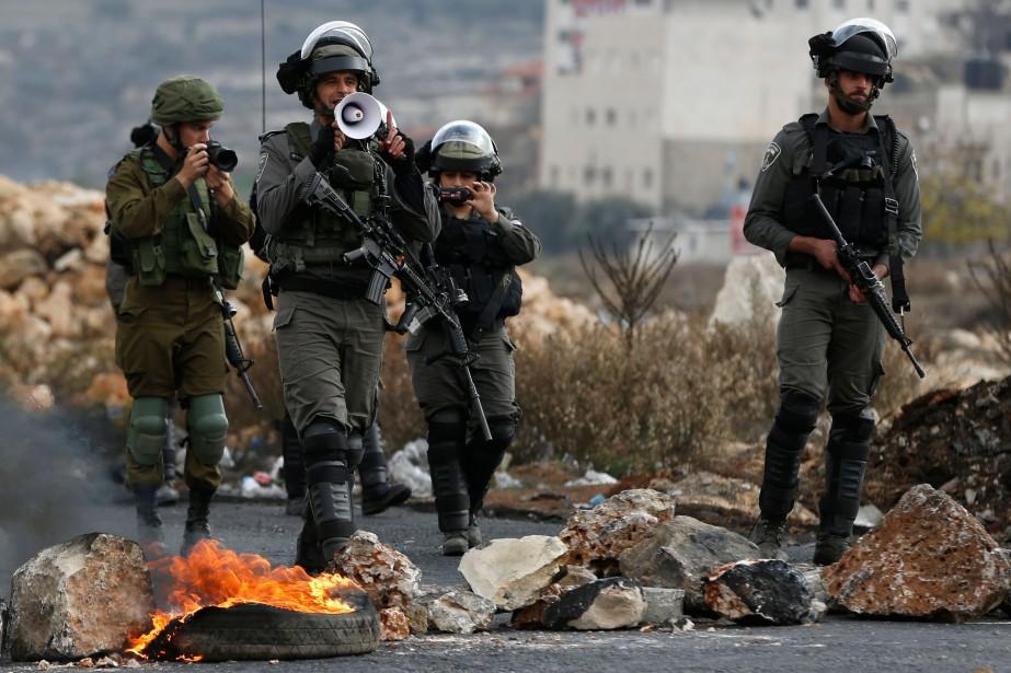 Les frappes israéliennes ont fait trois blessés légers,... (AFP)