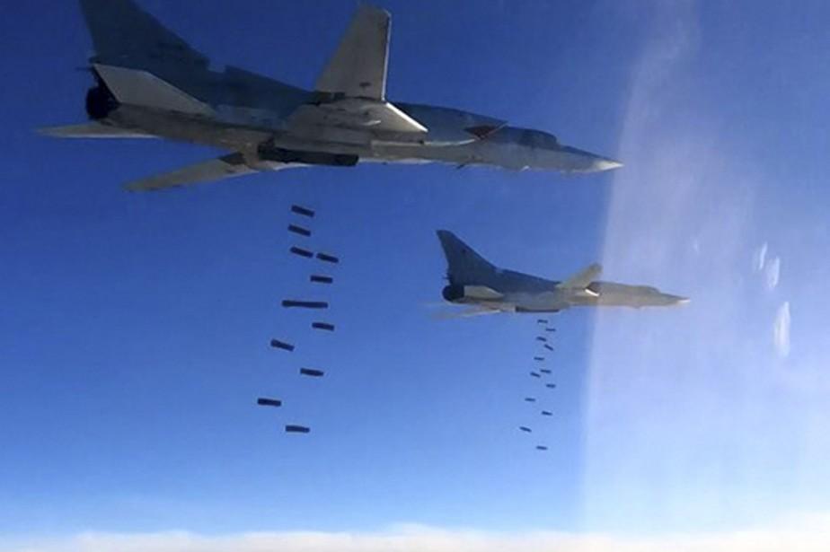 Selon l'ONG, «les raids menés probablement par l'aviation... (Photo AP)
