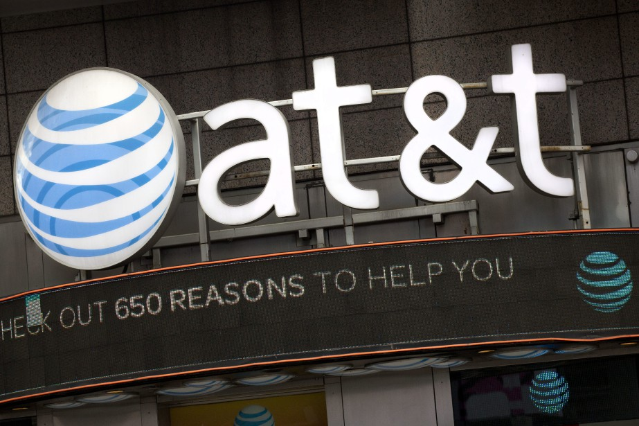 Des entreprises américaines comme AT&T et... (PHOTO Mark Lennihan, ARCHIVES AP)