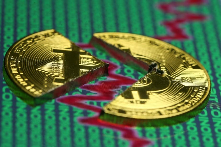 Le prix d'un bitcoin était monté lundi à... (Photo Dado Ruvic, REUTERS)