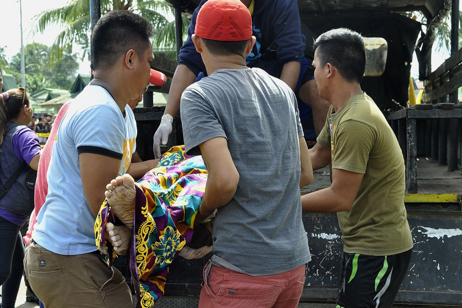 La tempête tropicaleTembina fait 240 morts aux Philippines,... (Merlyn MANOS, AFP)