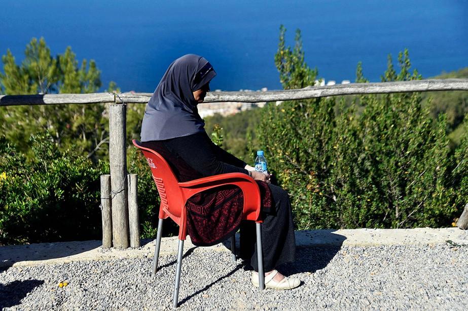 Linda, mère de trois enfants, a été abandonnée... (RYAD KRAMDI, AFP)