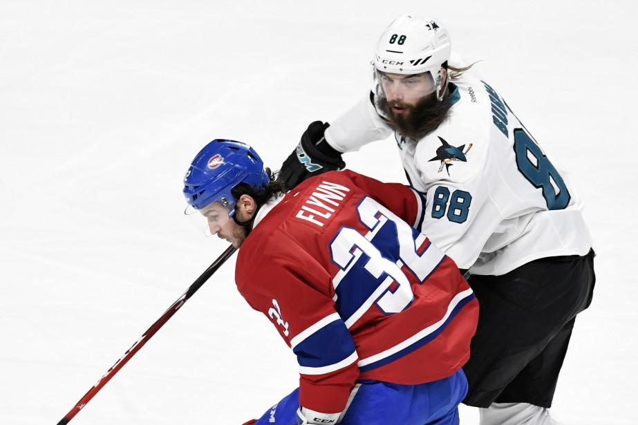 Brian Flynn, des Canadiens, et Brent Burns, des Sharks, lors d'un match au Centre Bell le 16 décembre 2016. | 2 janvier 2018
