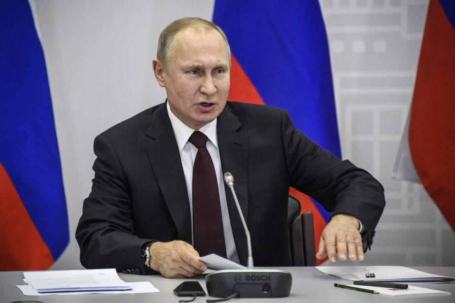 Le président russe Vladimir Poutine... (Photo Alexander Nemenov, AP)