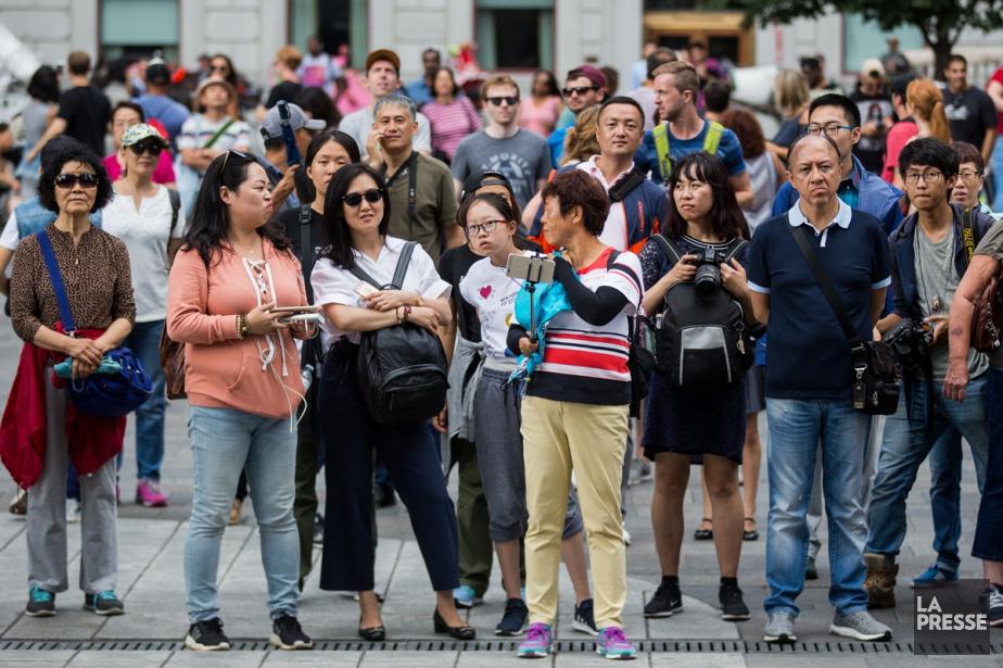 Des Chinois en visite à Montréal.... (PHOTO SIMON GIROUX, ARCHIVES LA PRESSE)