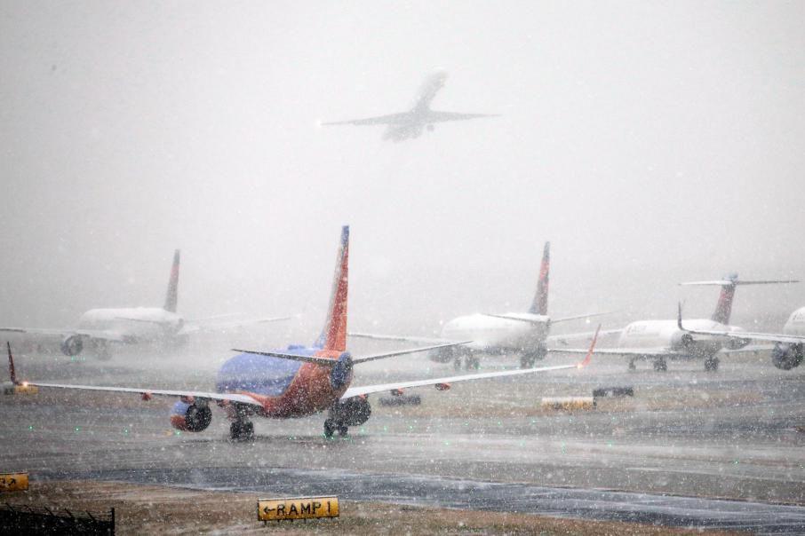 Tempête de neige, froid sibérien, pluie verglaçante: prendre... (PhotoBob Andres, archives Associated Press)