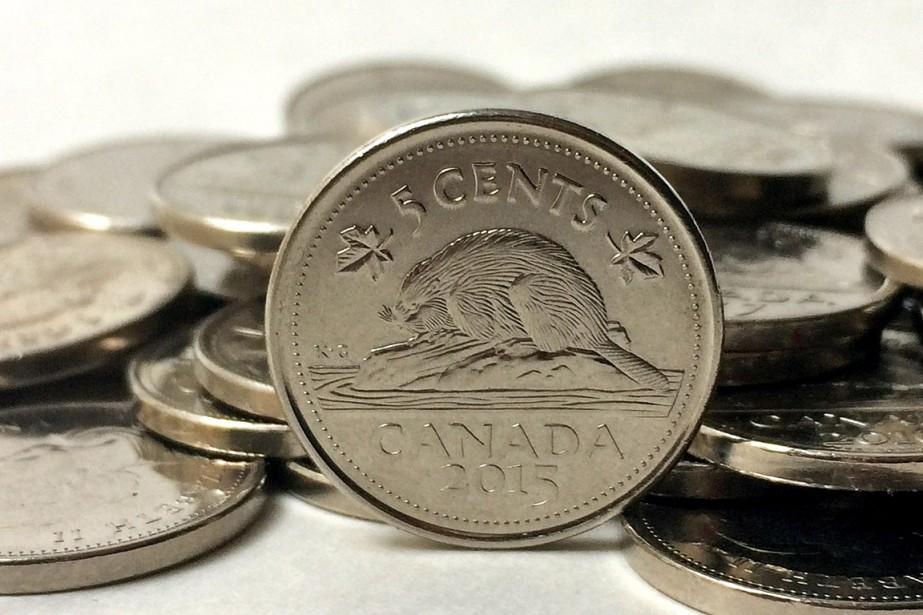 Lapièce de 5sous pourrait connaître le même sort... (PHOTO GRAEME ROY, ARCHIVES LA PRESSE CANADIENNE)