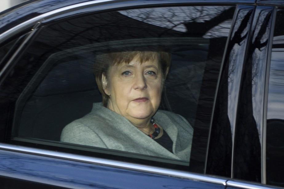 Angela Merkel.... (Photo Gregor Fischer, dpa via AP)
