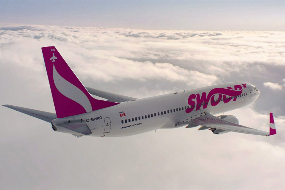 Le premier avion rose et blanc de la... (PHOTO LA PRESSE CANADIENNE/WESTJET)