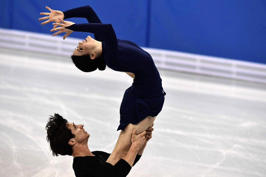 Les Canadiens Tessa Virtue et Scott Moir à... (PHOTO ARIS MESSINIS, AGENCE FRANCE-PRESSE)