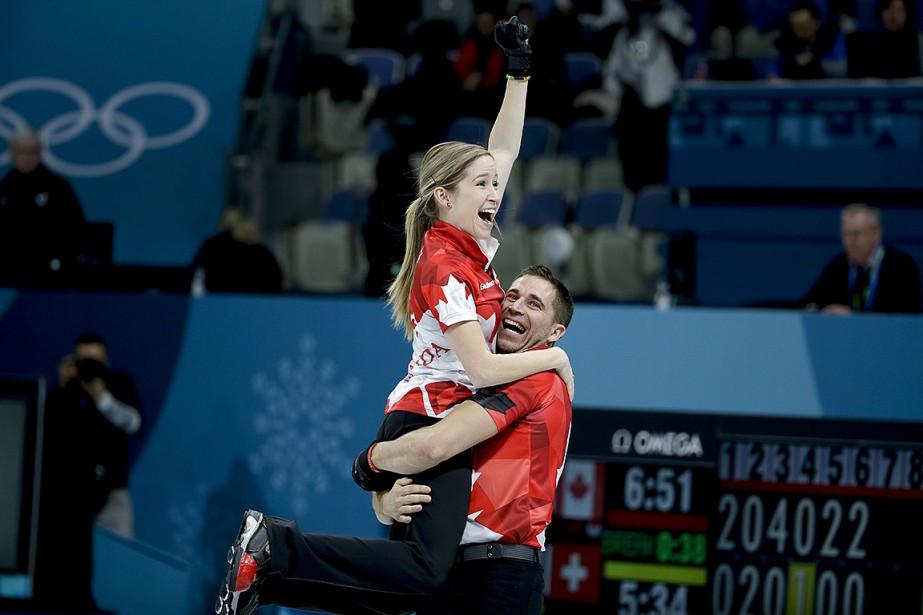 Les Canadiens John Morris et Kaitlyn Lawes (photo)... (Photo Natacha Pisarenko, Associated Press)