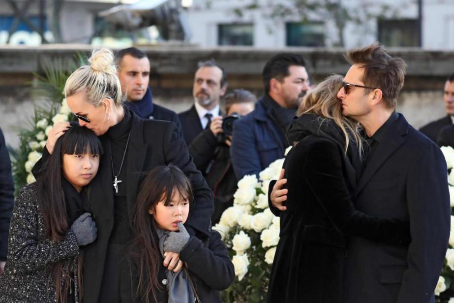 La famille de JohnnyHallyday lors de ses funérailles,... (Photo LudovicMarin, archives Agence France-Presse)