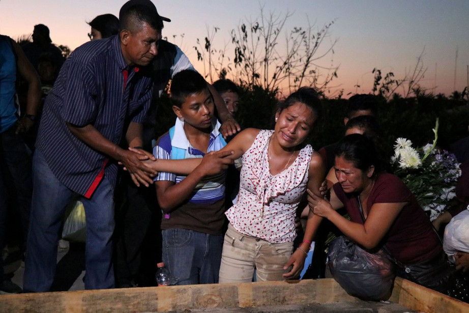 Des proches de victimes ont assisté à des... (PHOTO REUTERS)