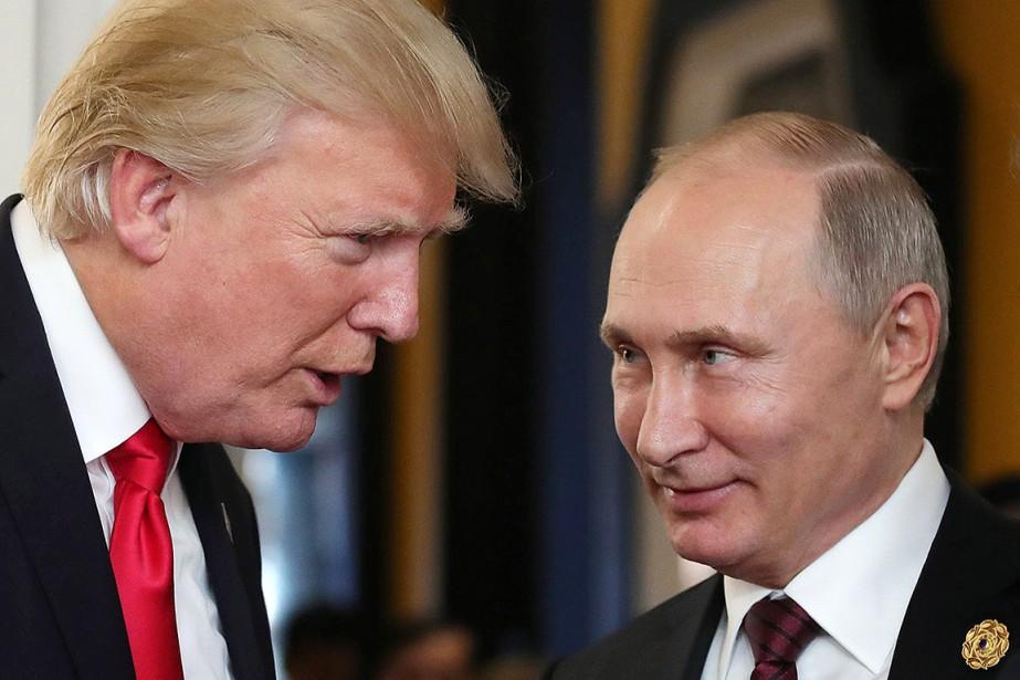 Donald Trump et Vladimir Poutine, photographiés le 11... (Mikhail KLIMENTYEV, SPUTNIK VIA AFP)