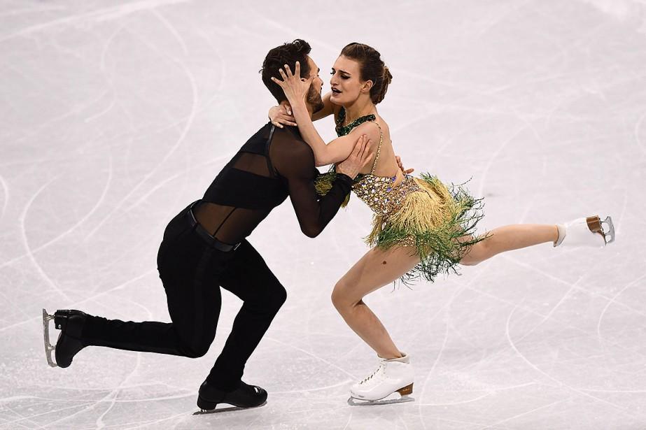 Gabriella Papadakis et Guillaume Cizeron ont fait bonne... (ARIS MESSINIS, AFP)