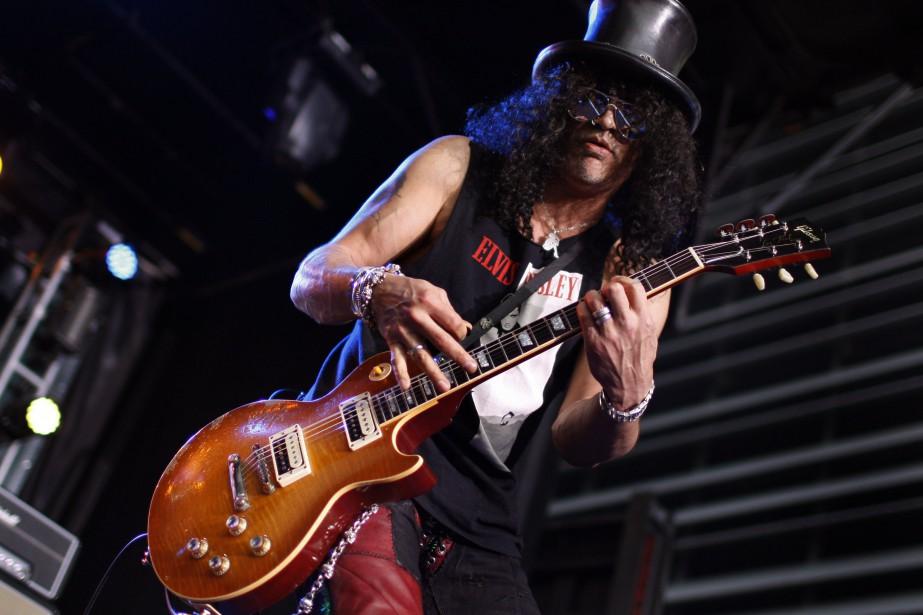 Le guitariste Slash est l'un des nombreux fidèles... (archives REUTERS)