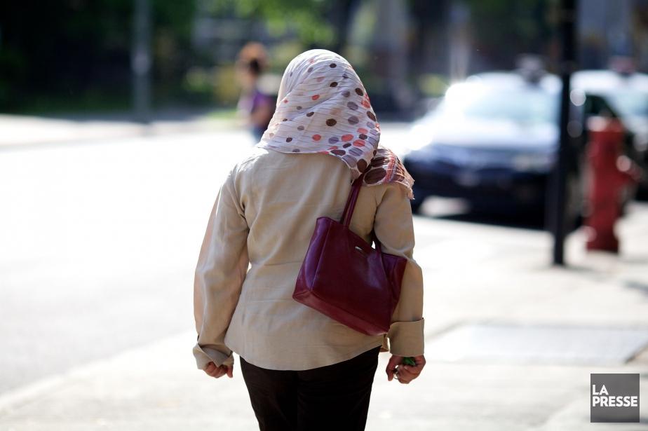 Le changement règlementaire permettra à une femme voilée... (Photo Sarah Mongeau-Birkett, archives La Presse)
