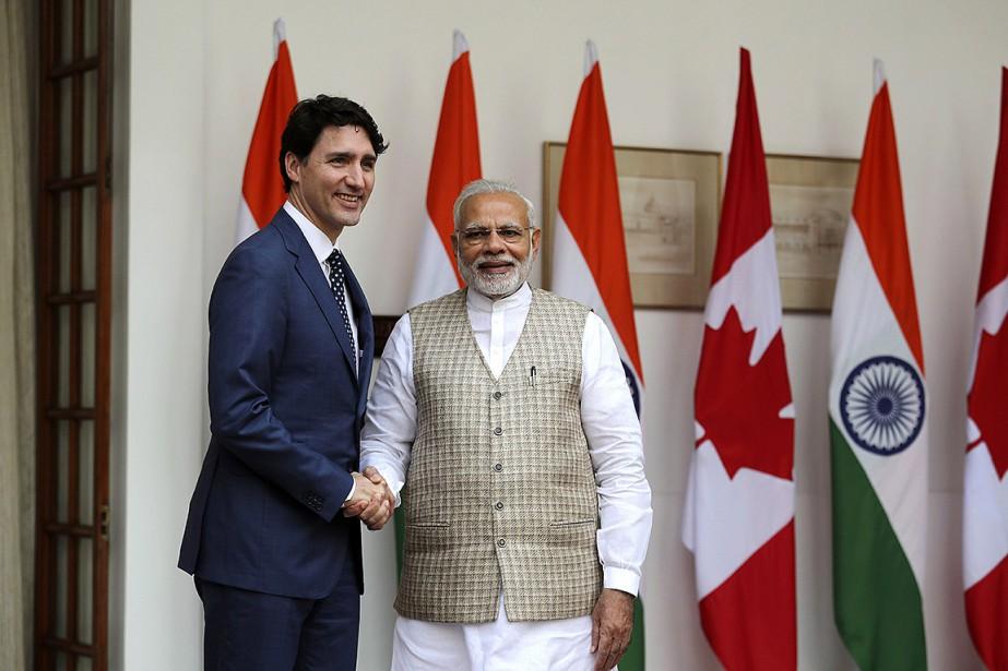 Les premiers ministres canadien et indien, Justin Trudeau... (Manish Swarup, AP)