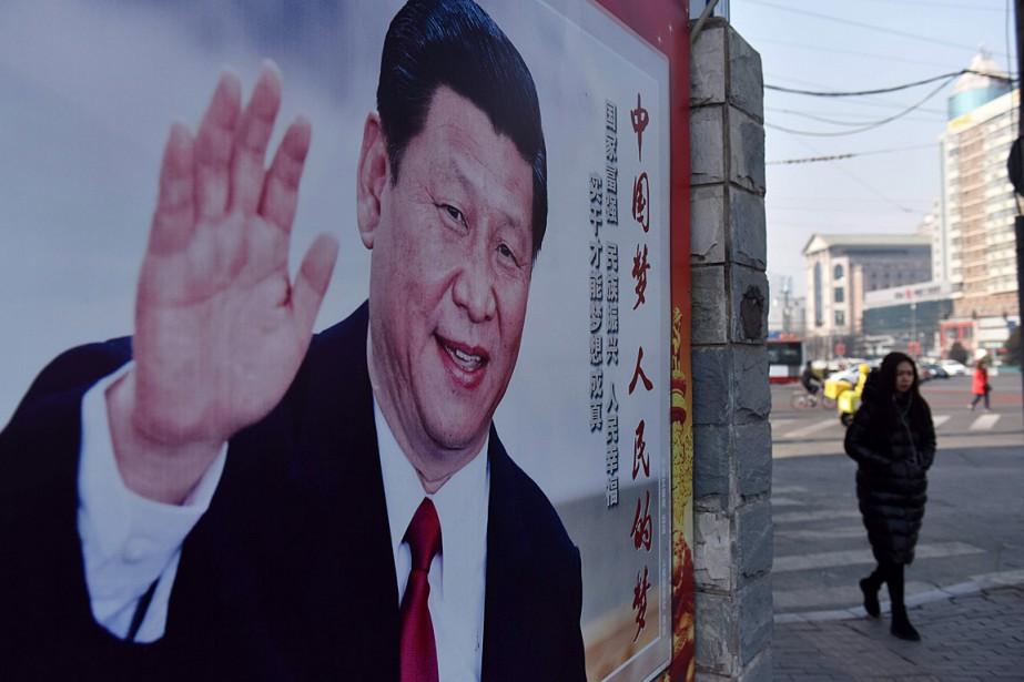 Alors que leprésident Xi Jinping aurait dû quitter... (PHOTO GREG BAKER, AGENCE FRANCE-PRESSE)