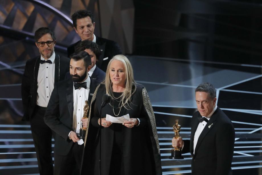 Lee Unkrich et Darla K. Anderson ont accepté l'Oscar du meilleur long métrage d'animation, pour <em>Coco</em>. (REUTERS)