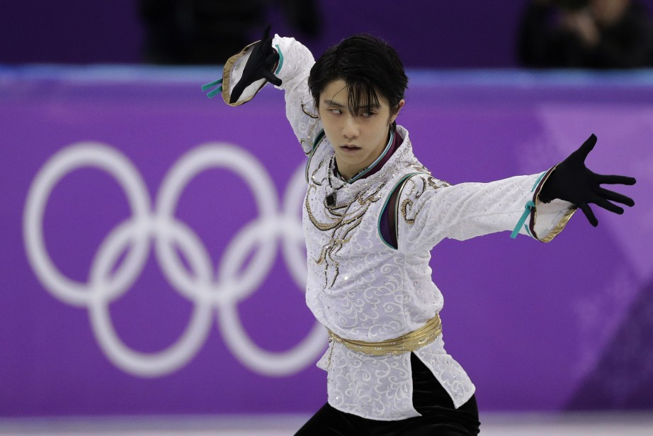 Yuzuru Hanyua remporté la médaille d'or aux Jeux... (Photo David J. Phillip, AP)
