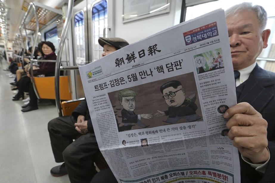 Les journaux sud-coréens se demandent que cachent Donald... (Phoot Ahn Young-joon, AP)