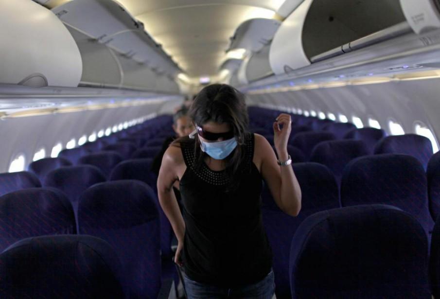 Les risques de contamination sont limités lorsqu'un passager... (Photo Rodrigo Abd, Archives Associated Press)