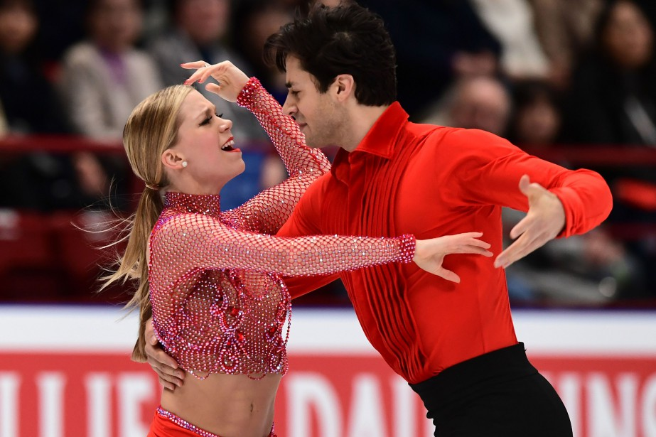Les patineurs canadiens Kaitlyn Weaver et Andrew Poje... (Photo Miguel Medina, archives AFP)
