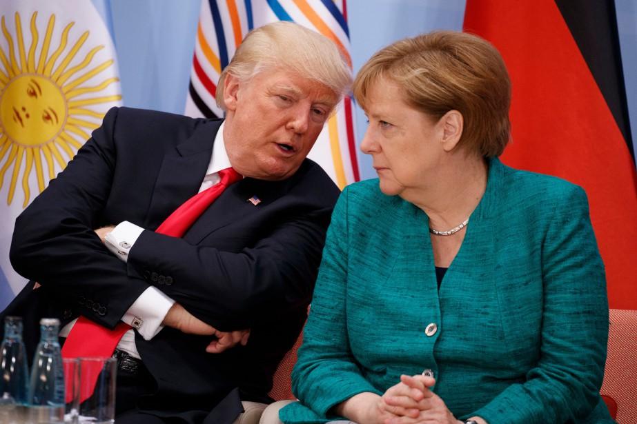 Donald Trump et Angela Merkel lors du G20... (ARCHIVES AP)