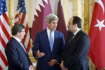 Cette photo montrant John Kerry avec ses homologues...