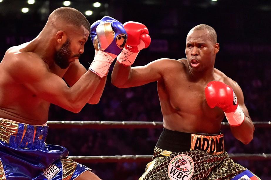 Le combat entre Adonis Stevenson (à droite) et... (PHOTO FRANK GUNN, LA PRESSE CANADIENNE)