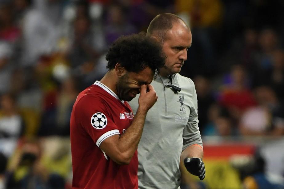 Certains ont fondu en larmes en voyant leur... (PHOTO AFP)