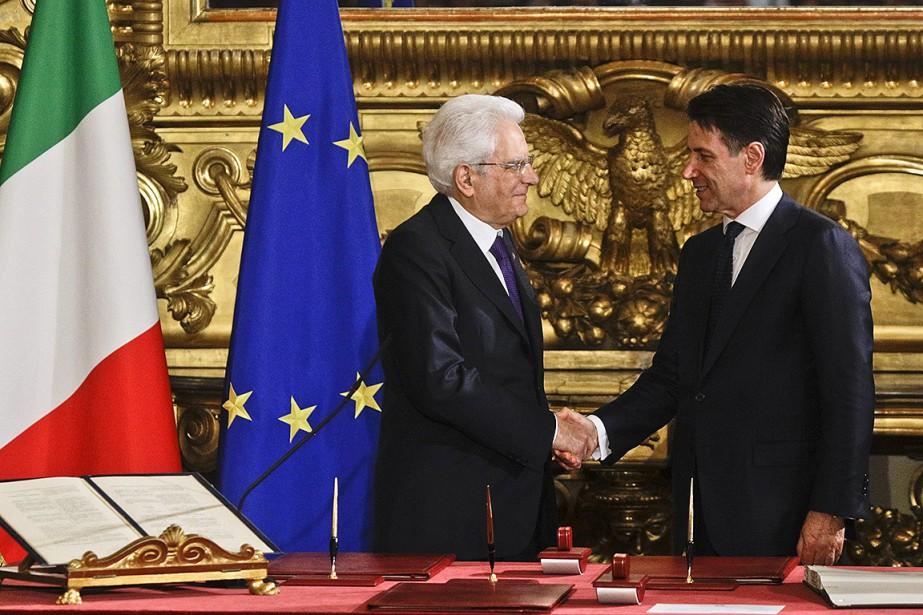 Le président de l'Italie Sergio Mattarella et Giuseppe... (Gregorio Borgia, AP)